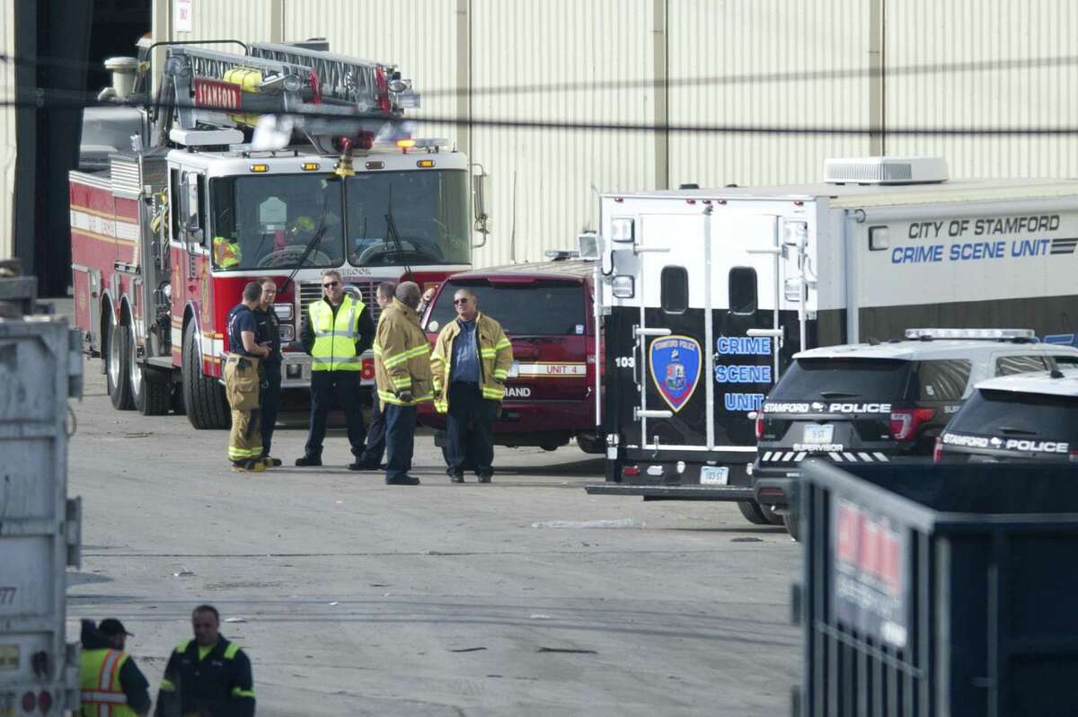 Emergency personnel respond to a report of a dead baby at City Carting & Recycling in Stamford on Tuesday.