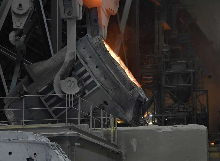 A cauldron of melted steel moves into position to be poured into the supply system for producing rolls of sheet steel at the NUCOR Steel Gallatin plant, Wednesday, July 25, 2018, in Ghent, Ky. NUCOR, one of the largest Manufacturers and revyvlers of steel in the US is working at full capacity seven days a week to meet demand. (AP Photo/Timothy D. Easley)