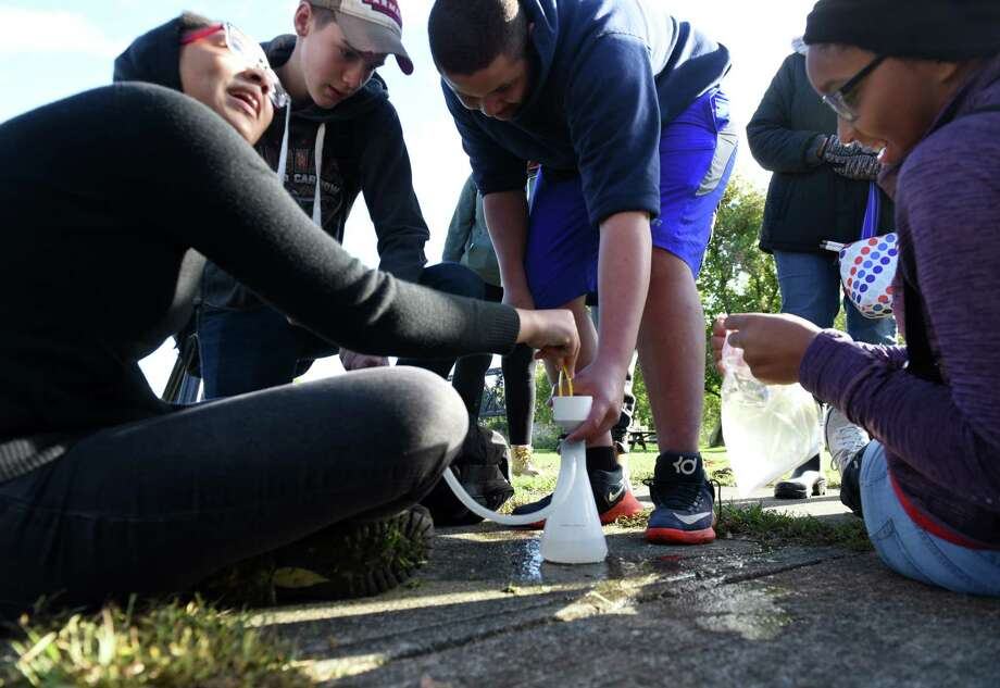 Cohoes High School ninth graders extract a DNA sample from the Hudson River during a student science workshop to detect DNA from invasive species on Tuesday morning, Oct. 16, 2018, at Peebles Island in Waterford, N.Y. The Annual Day in the Life of The Hudson and Harbor event included 85 locations from New York City to Peebles Island. Students conducted their own research about the river's ecosystem, and learned how scientists are working to protect the River. (Will Waldron/Times Union) Photo: Will Waldron, Albany Times Union / 20045156A