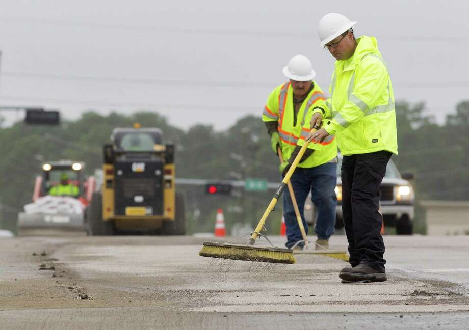 PHOTOS: Worst traffic in Houston suburbsHazmat crews work to clean up drilling mud from the FM 3083 overpass above I-45 on Tuesday, Oct. 16, 2018, in Conroe. The Conroe Fire Department and TXDOT responded to the scene after the slick substance was discovered from I-45 along FM 3083 to an area behind Conroe-North Houston Regional Airport where a hazardous material dump site is located.>>See photos of high traffic areas in Houston... Photo: Jason Fochtman, Houston Chronicle / Staff Photographer / © 2018 Houston Chronicle