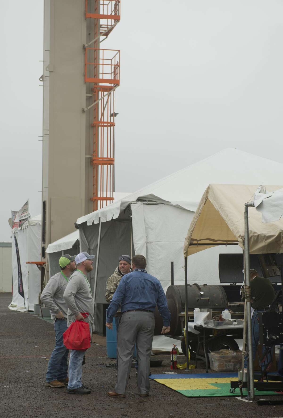 Permian Basin International Oil Show attendees talk with industry suppliers in this 2018 file photo. After a year's delay because of the pandemic, organizers are looking forward to putting on the exhibition this October.