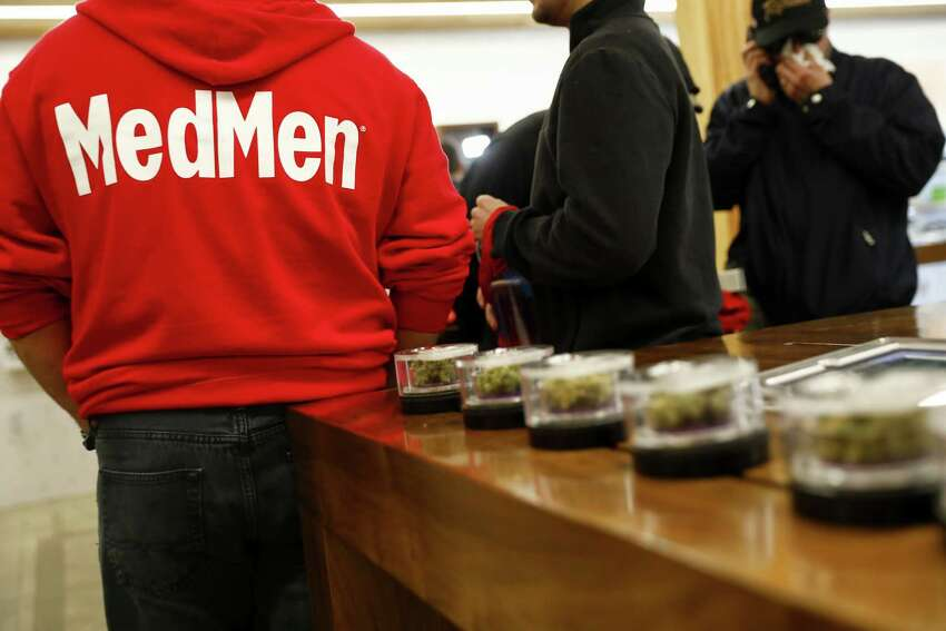 An employee speaks to customers at the MedMen dispensary in West Hollywood, California, U.S., on Tuesday, Jan. 2, 2018. California launched legal marijuana Monday, and customers lined up to celebrate the historic moment in San Diego, Sacramento and Oakland -- some of the municipalities given the green light to start sales on January 1. Meantime, in Los Angeles and San Francisco, the state's first- and fourth-largest cities, customers were turned away empty handed.Photographer: Patrick T. Fallon/Bloomberg
