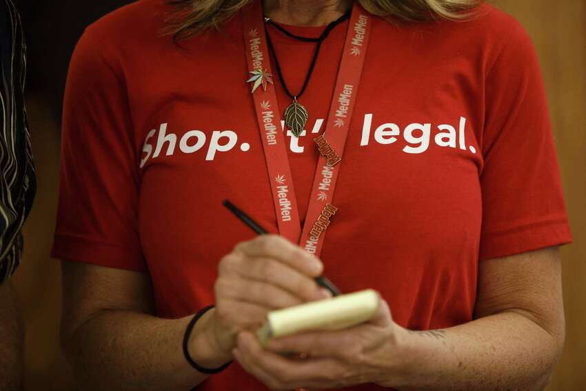 An employee wears a shirt reading