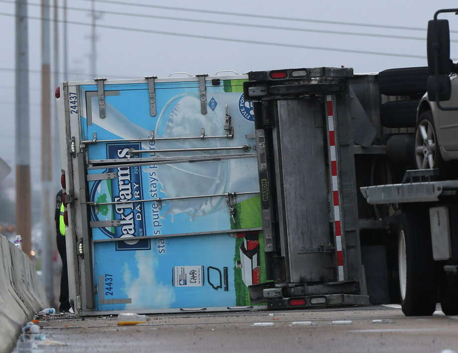 Lanes reopen after milk delivery truck overturns on