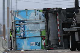 A delivery truck is turned over after involved in a crash, possibly with another vehicle, at Interstate Highway 69 Southwest southbound and Fondren Road on Tuesday, Oct. 16, 2018, in Houston. Three main lanes and the right shoulder were blocked and the traffic was backed up.