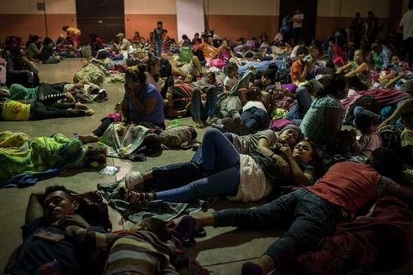 Honduran migrants rest inside an improvised shelter in Esquipulas, Guatemala. Starting in San Pedro Sula, Honduras, a group of more than 1,000 Honduran migrants arrived in Esquipulas on Monday.