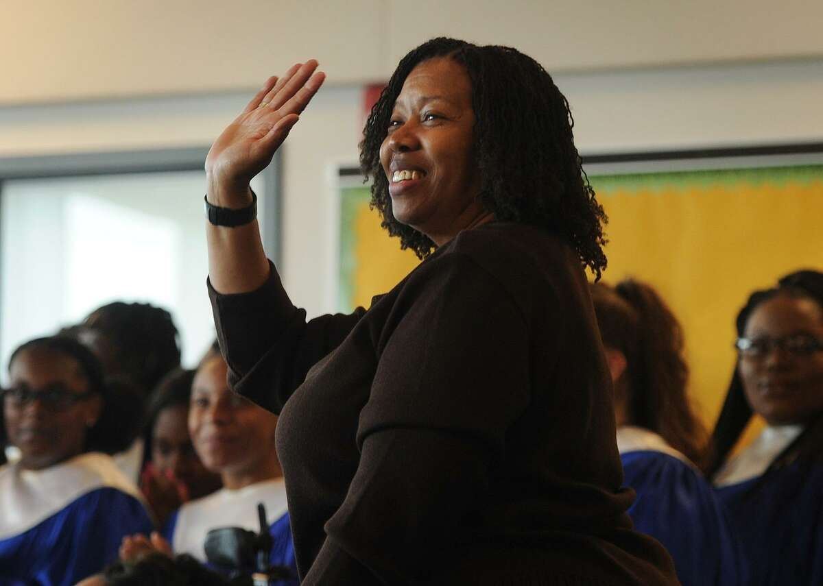 Harding High School music teacher Sheena Graham acknowledges her announcement as Connecticut's Teacher of the Year in a ceremony at the school in Bridgeport on Tuesday.