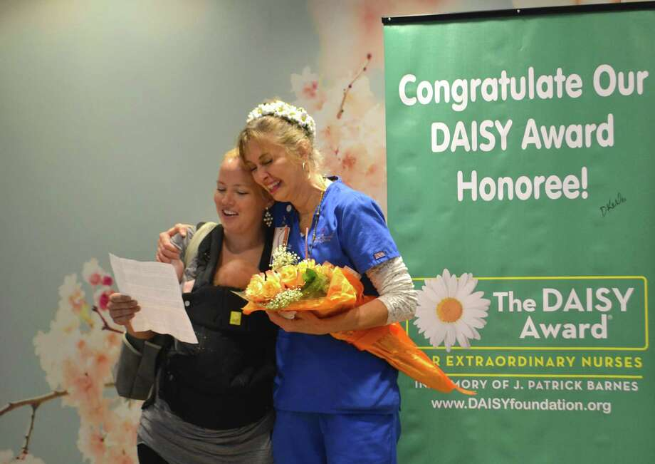 CRMC patient Jessica is pictured with her baby and CRMC Labor and Delivery nurse Karen Jones when Jones was awarded The DAISY Award for the month of August. Jones assisted Jessica with her birth and Jessica nominated her for the new DAISY Award which recognizes exceptional nursing. Photo: Photo Courtesy CRMC