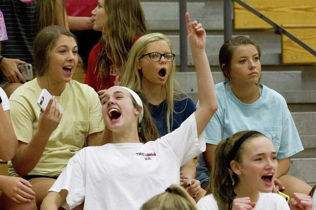 Students cheer as The Woodlands is introduced before a District 15-6A high school volleyball match at The Woodlands High School, Friday, Oct. 12, 2018, in The Woodlands.
