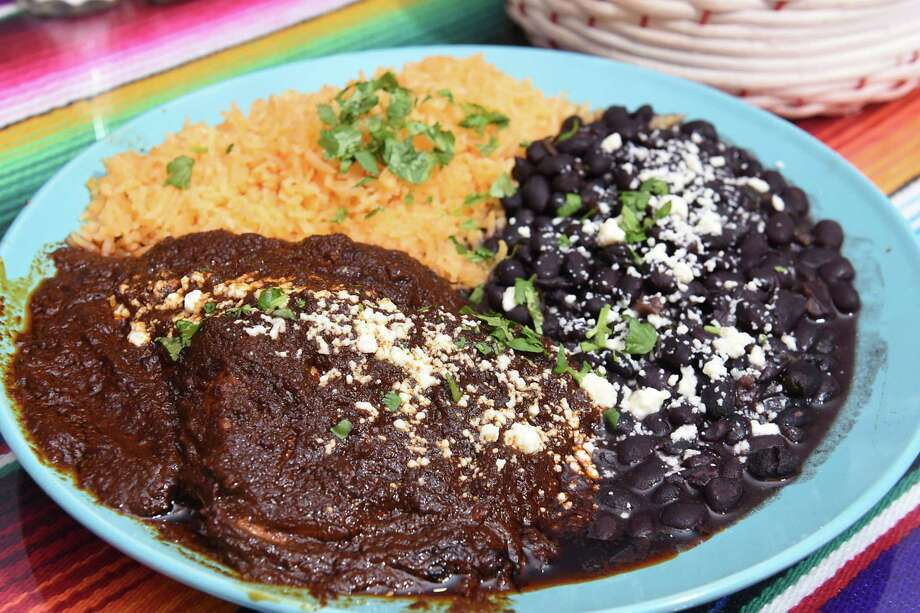 Mole, a traditional Mexican dish, is a dark sauce made from chocolate, chili peppers and a number of flavorful spices. Photo: Lori Van Buren /Albany Times Union / 20039883A