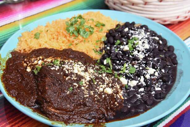 Mole, a traditional Mexican dish, is a dark sauce made from chocolate, chili peppers and a number of flavorful spices.