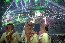 """Fans film the opening of WWE's """"Greatest Royal Rumble"""" event in Jeddah, Saudi Arabia, on April 27, 2018."""