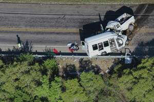 Investigators comb over the scene of an accident where 13 individuals were killed after a bus collided with a pickup head-on March 29, 2017, south of Garner State Park on U.S. 83. The bus was carrying a group from the New Braunfels First Baptist Church. The National Transportation Safety Board on Tuesday released a summary of its investigation of the 2017 crash that killed 13 people from New Braunfels.