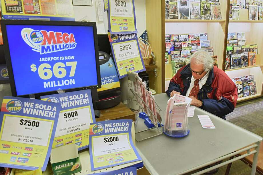 Joe Romano of Loudonville, N.Y., fills out his numbers to buy a Mega Millions lottery ticket at Coulson's News Center on Tuesday, Oct. 16, 2018, in Latham, N.Y. Photo: Lori Van Buren, Albany Times Union / 20045161A