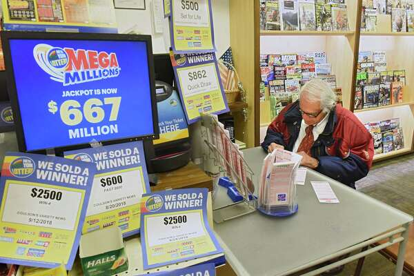 Joe Romano of Loudonville fills out his numbers to buy a Mega Millions lottery ticket at Coulson's News Center on Tuesday, Oct. 16, 2018 in Latham, N.Y. Mega Millions jackpot is currently $667 Million. (Lori Van Buren/Times Union)