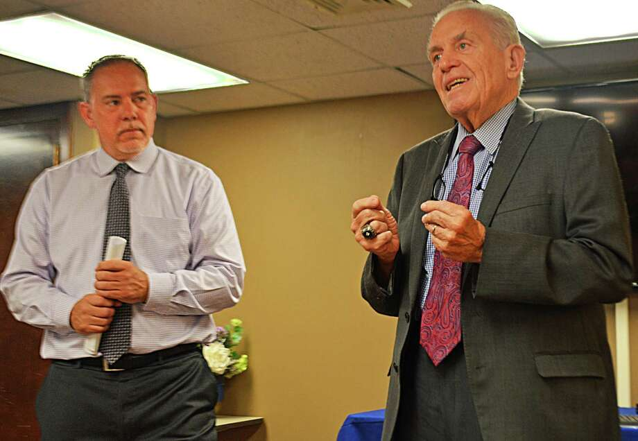 Speaker of the House Joe Aresimowicz, left, announced the creation of the Blue Ribbon Panel on Tourism Tuesday morning at the Middlesex Chamber of Commerce in Middletown. The committee would consist of representatives from transportation, lodging, cultural destinations and other industries. At right is Middlesex County Chamber of Commerce President Larry McHugh. Photo: Cassandra Day / Hearst Connecticut Media