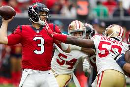Houston Texans quarterback Tom Savage (3) passes the footbll as he is pressured by San Francisco 49ers defensive end Elvis Dumervil (58) during the second quarter of an NFL football game at NRG Stadium on Sunday, Dec. 10, 2017, in Houston. ( Brett Coomer / Houston Chronicle )