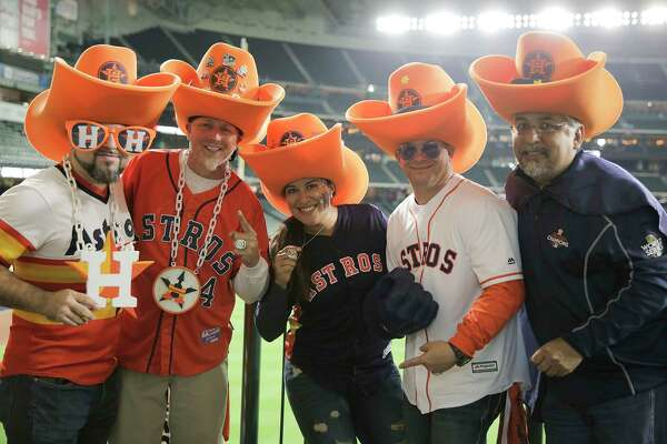 Astros fans pose for a photo before the third game of the ALCS series between the Houston Astros and the Boston Red Sox at Minute Maid Park on Tuesday, Oct. 16, 2018 in Houston.