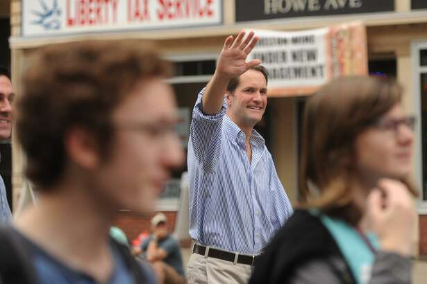U.S. Rep. Jim Himes marches in Shelton's Columbus Day Parade. He has raised $2.5 million in his bid for a seventh term.