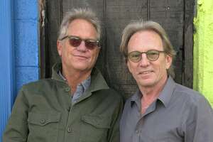 America (Gerry Beckley, left, and Dewey Bunnell) are touring next year in celebration of the band's 50th anniversary.