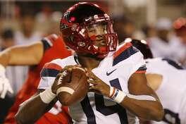 Arizona quarterback Khalil Tate (14) passes against Utah in the first half during an NCAA college football game Friday, Oct. 12, 2018, in Salt Lake City. (AP Photo/Rick Bowmer)