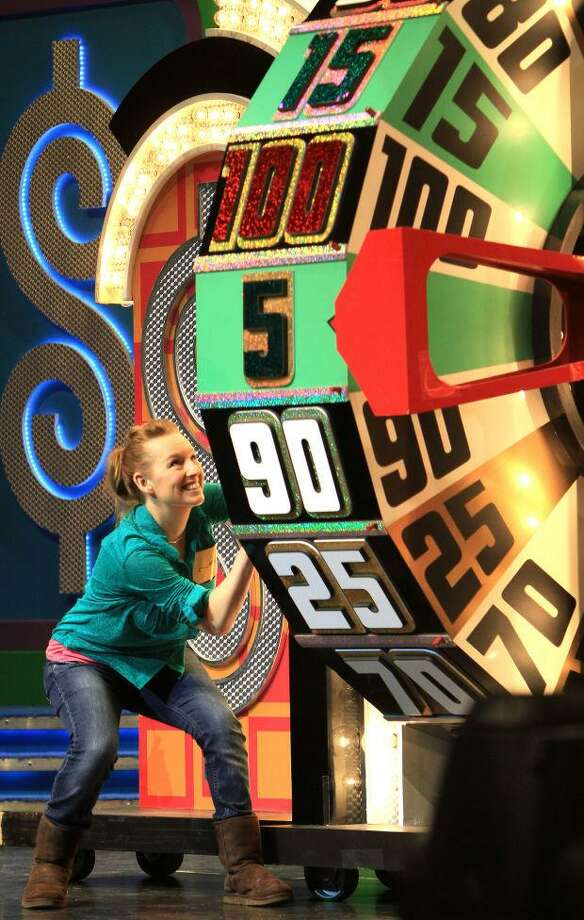 "A woman competes at the wheel on ""The Price is Right Live!"" Photo: Courtesy Of Foxwoods / Contributed Photo"