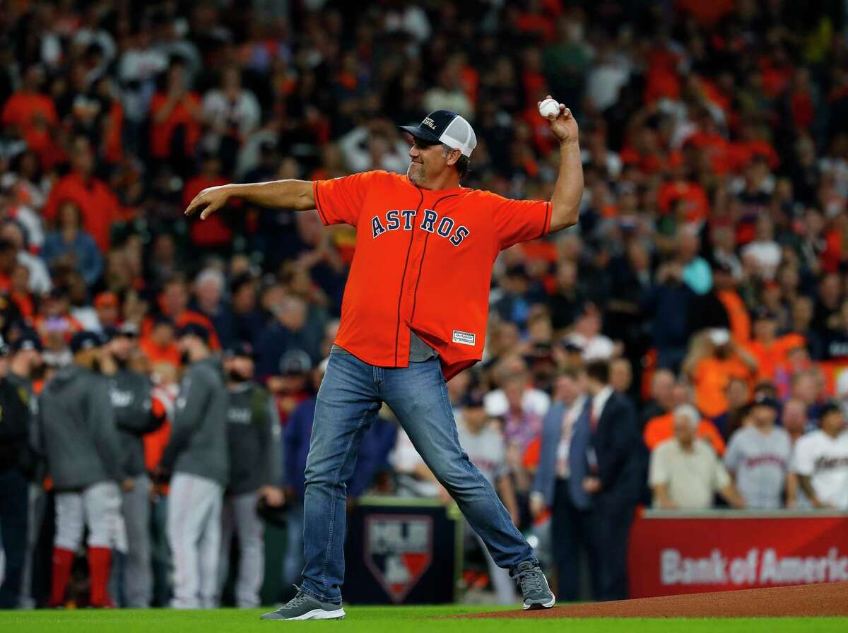 Former Houston Astro Lance Berkman throws out the ceremonial first pitch before Game 3 of the American League Championship Series at Minute Maid Park on Tuesday, Oct. 16, 2018, in Houston.