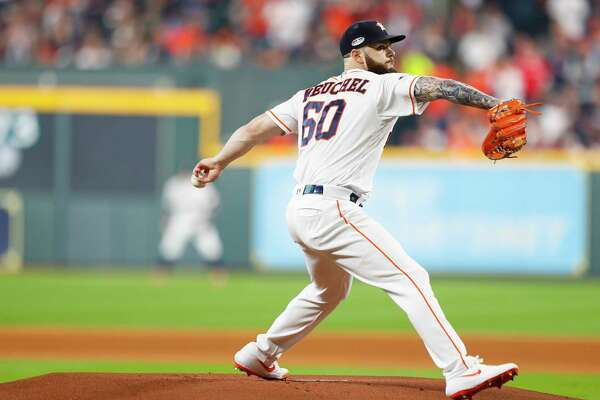 Houston Astros starting pitcher Dallas Keuchel (60) throws the first pitch during the first inning of Game 3 of the American League Championship Series at Minute Maid Park on Tuesday, Oct. 16, 2018, in Houston.