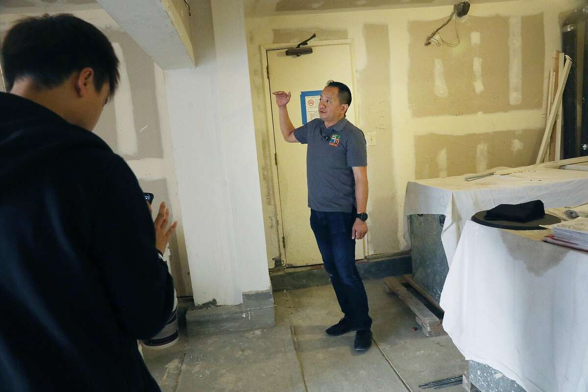George Mak, SGDM director, stands next to a strong wall (directly at left of Mak) at a building that is being seismically retrofitted on Tuesday, October 16, 2018 in San Francisco, Calif.