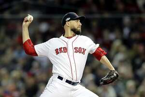 BOSTON, MA - OCTOBER 14:  Matt Barnes #32 of the Boston Red Sox delivers the pitch during the fifth inning against the Houston Astros in Game Two of the American League Championship Series at Fenway Park on October 14, 2018 in Boston, Massachusetts.
