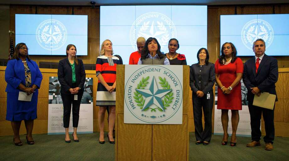 Houston Independent School District trustee Diana Dávila addresses the media with her fellow trustees during a press conference at the Hattie Mae White Educational Support Center in 2018.HISD's pursuit of a permanent superintendent will continue after trustees rejected a motion Thursday to suspend the search. Photo: Mark Mulligan, Houston Chronicle / Staff Photographer / © 2018 Mark Mulligan / Houston Chronicle