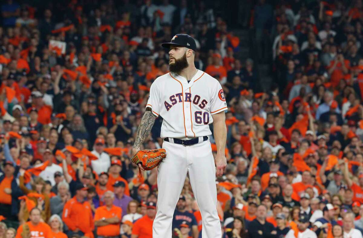 Houston Astros starting pitcher Dallas Keuchel (60) pitches during the first inning of Game 3 of the American League Championship Series at Minute Maid Park on Tuesday, Oct. 16, 2018, in Houston.