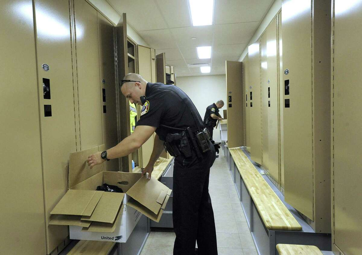Bethel Police Officer Greg Emerson moves his belongings into his locker at the new Bethel Police Station on Judd Avenue in Bethel, Tuesday, Oct. 16, 2018.