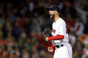 BOSTON, MA - OCTOBER 14:  Rick Porcello #22 of the Boston Red Sox celebrates after retiring the side in the top of the eighth inning against the Houston Astros in Game Two of the American League Championship Series at Fenway Park on October 14, 2018 in Boston, Massachusetts.