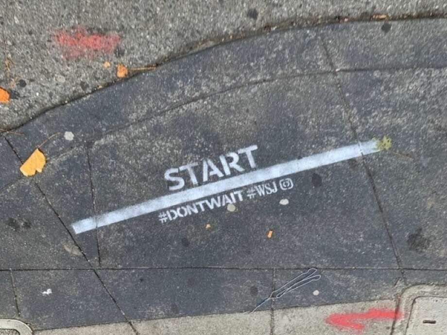 Last week, Hoodline reader Peter D. spotted at least six spray-painted adverts for the Wall Street Journal adorning sidewalks in the Financial District. Photo: Peter D./Hoodline Tipline