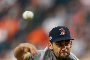 Boston Red Sox starting pitcher Nathan Eovaldi (17) pitches during the first inning of Game 3 of the American League Championship Series at Minute Maid Park on Tuesday, Oct. 16, 2018, in Houston.