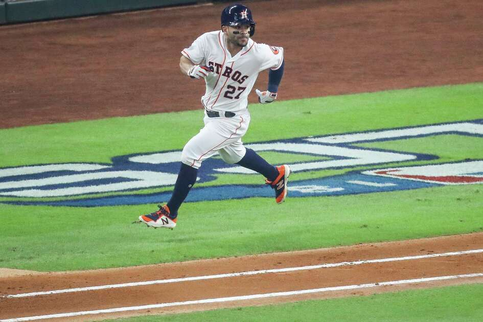 Houston Astros designated hitter Jose Altuve (27) runs to first after hitting a single during the first inning of Game 3 of the American League Championship Series at Minute Maid Park Tuesday Oct. 16, 2018 in Houston.