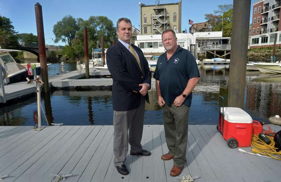 M.F. DiScala CFO Alan Webber and Norwalk Boat Club Commodore Steve Holian at the Club docks Tuesday, October 16, 2018, in Norwalk, Conn. Developer Michael F. DiScala is working with the city to apply for a grant to dredge the heavily silted upper harbor at The Norwalk Boat Club at 11 Wall St. DiScala, a neighbor and member of the boat club, presented the plan before the Wall Street Association during a meeting at the boat club on Tuesday. The grant would come through the Small Harbor Improvement Projects program. Photo: Erik Trautmann / Hearst Connecticut Media / Norwalk Hour