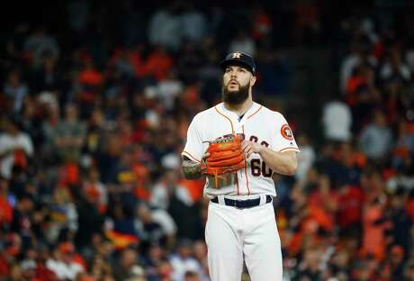 Houston Astros starting pitcher Dallas Keuchel (60) reacts after walking Boston Red Sox J.D. Martinez (28) during the third inning of Game 3 of the American League Championship Series at Minute Maid Park on Tuesday, Oct. 16, 2018, in Houston.