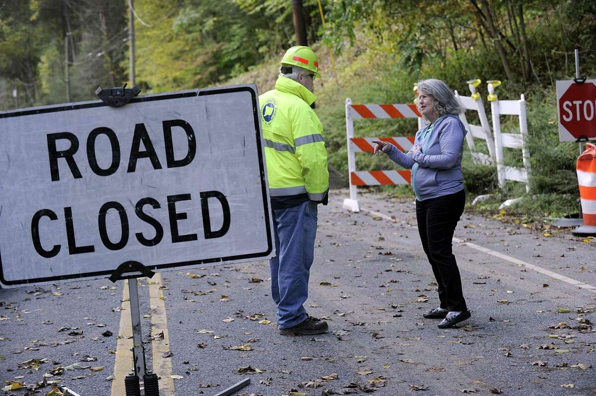 Terri Hahn, right, president of Timber Trails, talks with a DOT inspector Friday morning. Route 37 in Sherman, just north of Big Trail near the New Fairfield town line, was closed Sept. 6 to repair the washed out road from all of the rain this summer.