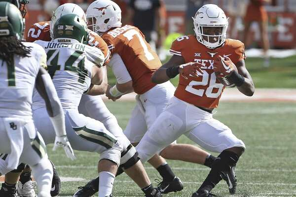 Longhorn running back Keaontay Ingram cuts into a hole as UT hosts Baylor at DKR Stadium on October 13, 2018.