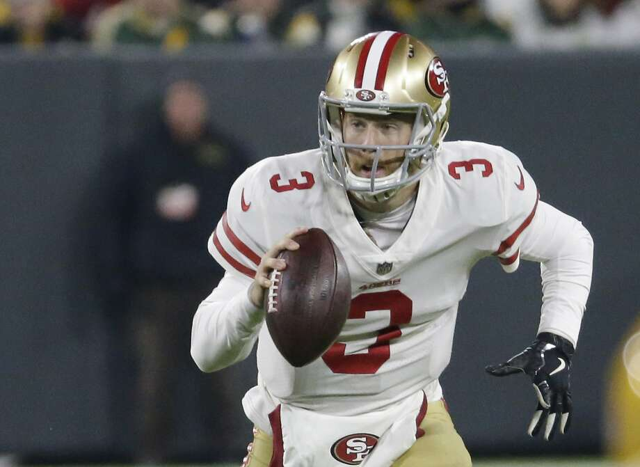 49ers quarterback C.J. Beathard runs against the Packers during the first half of Monday night's game in Green Bay. Photo: Mike Roemer / Associated Press