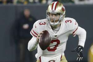 San Francisco 49ers quarterback C.J. Beathard (3) runs against the Green Bay Packers during the first half of an NFL football game Monday, Oct. 15, 2018, in Green Bay, Wis. (AP Photo/Mike Roemer)