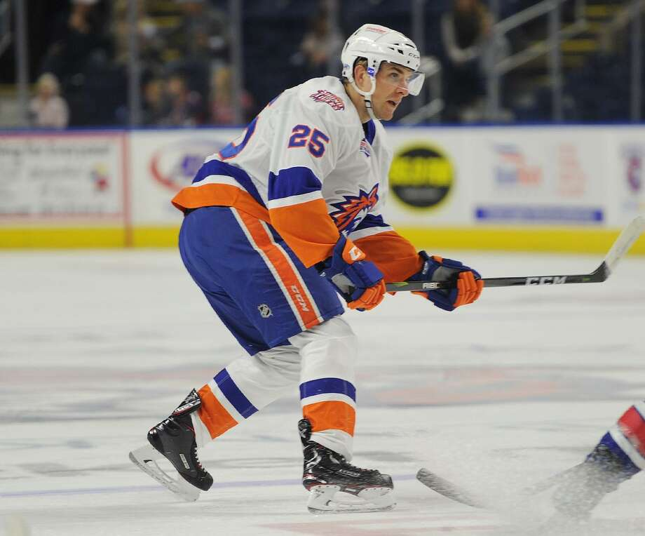 The Sound Tigers' Devon Toews looks for room against the Americans during a game on Saturday at the Webster Bank Arena in Bridgeport. Photo: Brian A. Pounds / Hearst Connecticut Media / Connecticut Post