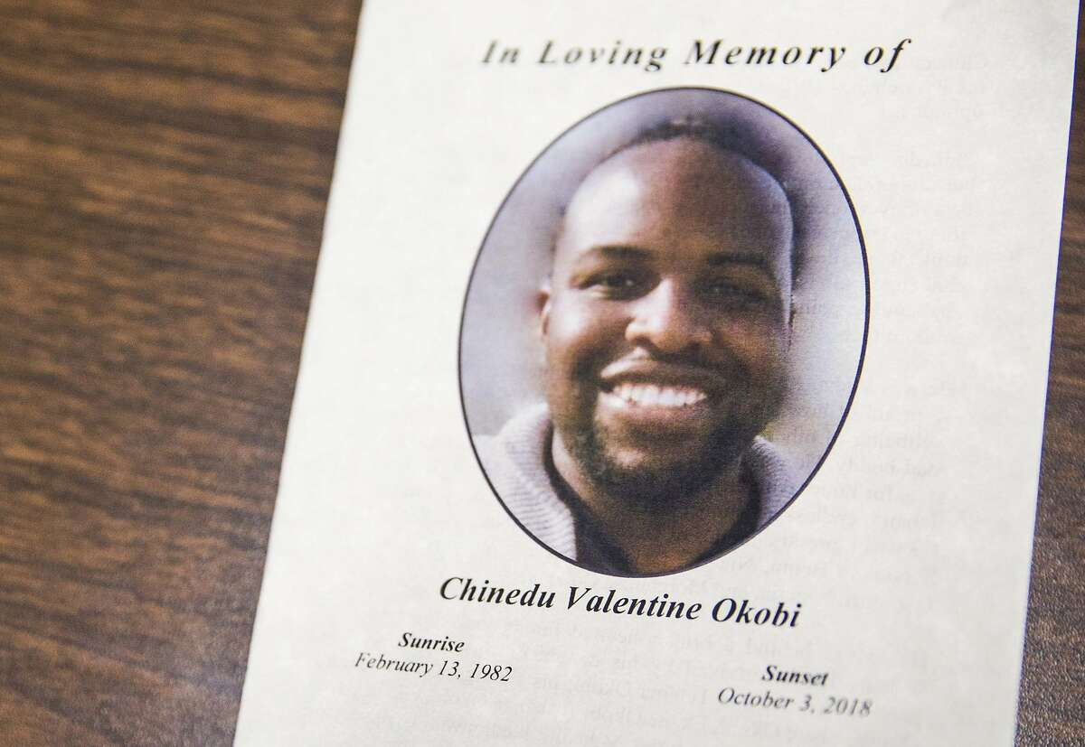 A pamphlet sits on a table during a press conference calling for an investigation into the death of Chinedu Okobi, in San Francisco on Oct. 16, 2018.