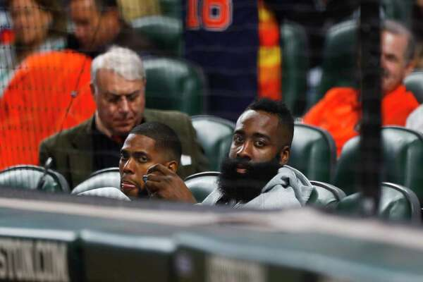 Houston Rockets guard James Harden watches Game 3 of the American League Championship Series at Minute Maid Park on Tuesday, Oct. 16, 2018, in Houston.