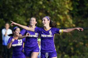 Westhill's Corinne Dente (9) celebrates her goal against Darien in the first half of a FCIAC girls soccer game in Stamford on Tuesday. Dente scored twice in a 2-1 win.