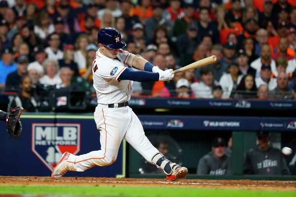 Houston Astros Alex Bregman (2) hits an RBI double that drives in Jose Altuve during the fifth inning of Game 3 of the American League Championship Series at Minute Maid Park on Tuesday, Oct. 16, 2018, in Houston.