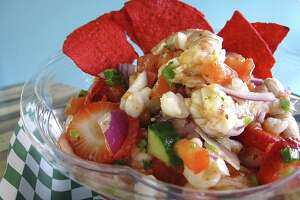 Custom-built shrimp ceviche with strawberries, red onions, pico de gallo, cucumbers, scallions and a light cocktail sauce on rice from Ceviche Ceviche.