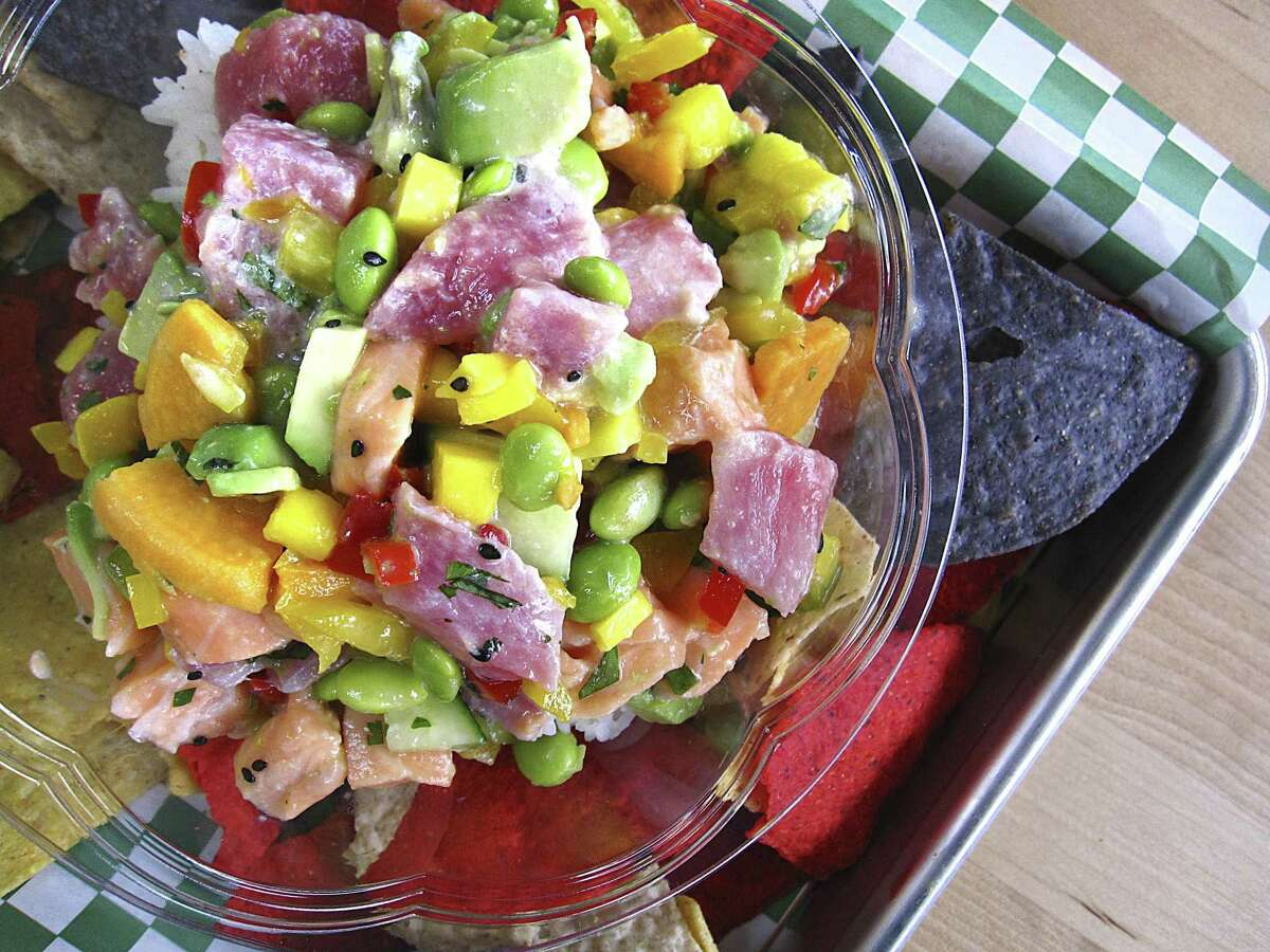 Ceviche with tuna, salmon, mango, black sesame, edamame, cilantro, sweet potato, bell peppers, cucumber and cilantro lime marinade on rice from Ceviche Ceviche.
